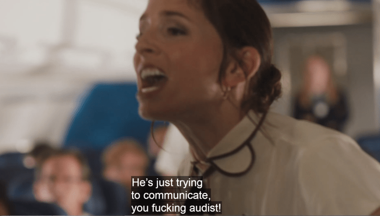 Kate yelling on an airplane: He's just trying to communicate, you fucking audist!