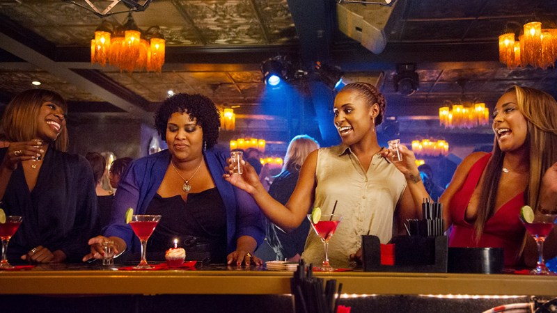 Issa Rae and friends are pictured in a party scene from the HBO show Insecure.