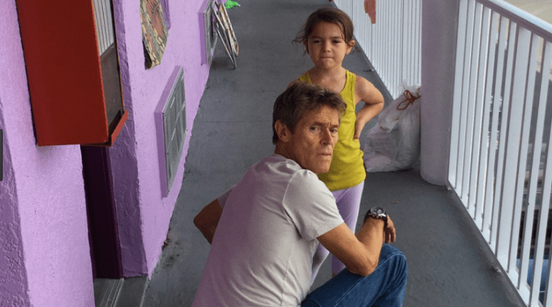 A still of Willem Dafoe and Brooklyn Prince on a hotel balcony in The Florida Project.