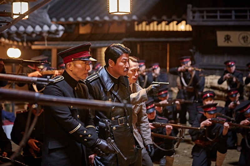 Pictured: Jung-chool (Song Kang-ho) and Japanese officers in the 2016 Kim Jee-woon spy thriller, Age of Shadows.
