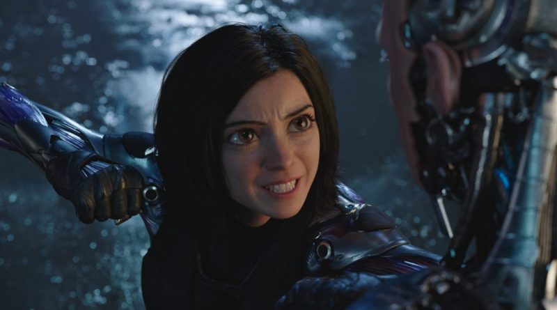 Alita threatens to punch a man with a strange expression. Source: Remezcla