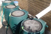 4 rain barrels connected in series