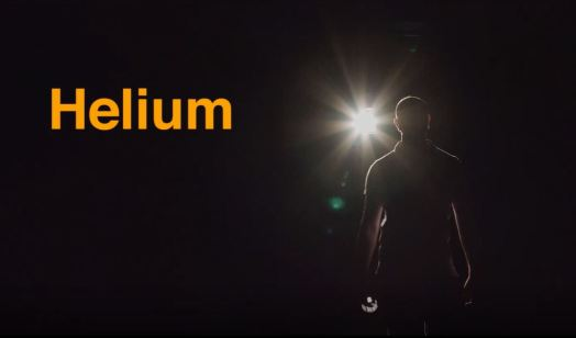 Helium, a silhouette of a man on stage.