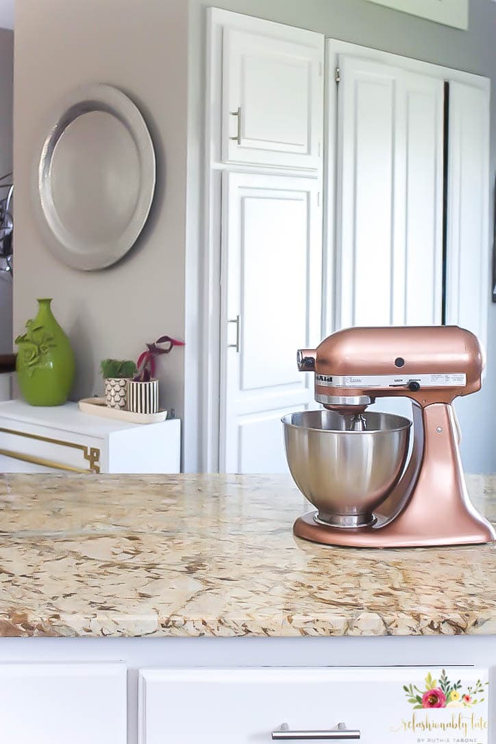copper kitchen aid metal cart how to paint a kitchenaid mixer refashionably late sitting on top of tan granite counter with white cabinets and