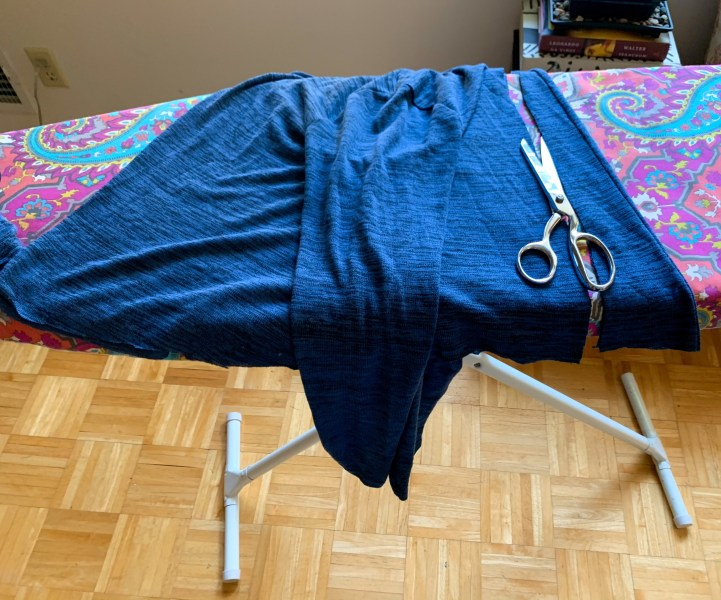 refashionista cutting back of top to make tie back top