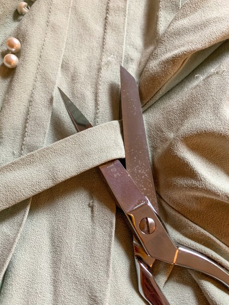 cutting of side ties of dress