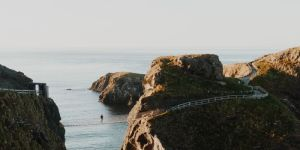 man on a rope bridge