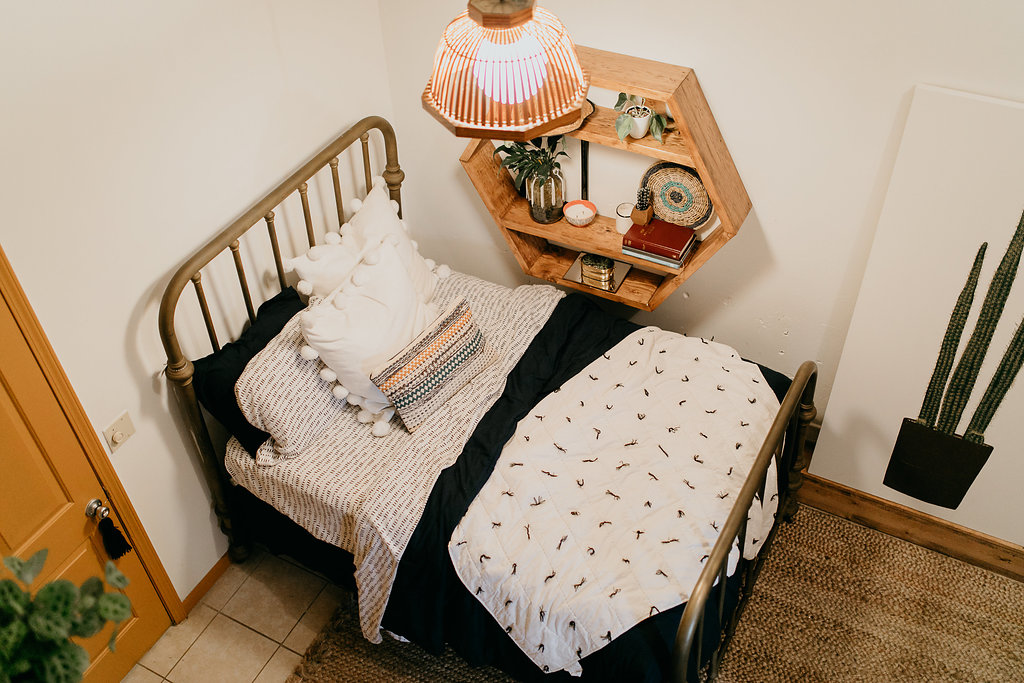 Above view of vintage bed with navy, white, and orange accents