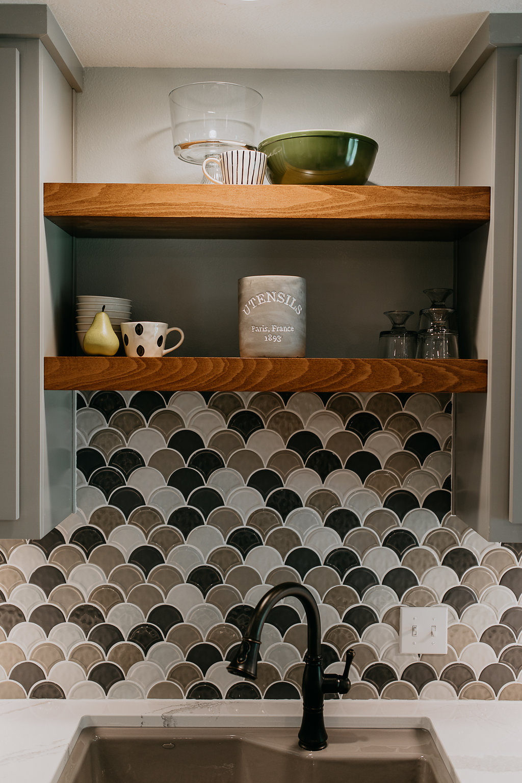Grey and wooden shelving, with backsplash, in contemporary kitchen
