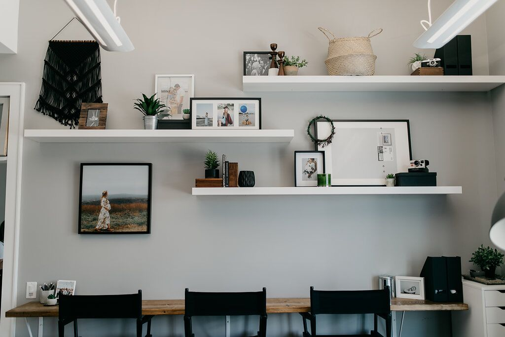 Office shelving with pictures, frames, and plants