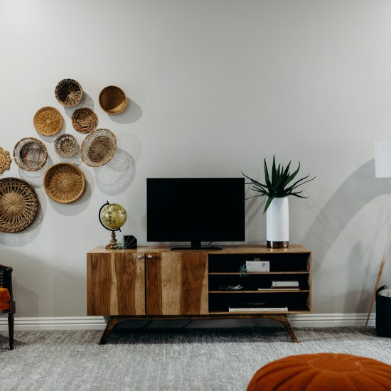 Wooden entertainment center with TV