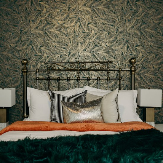Queen bed, orange and green throws and metallic pillows, springfield airbnb