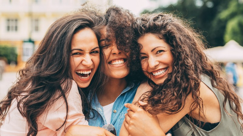 3 friends laughing and hugging