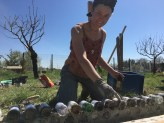Building a glass bottle wall, Provence, France, March 2017