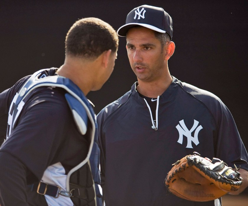 Gary Sanchez receives instrucyion from Jorge Posada Credit: New York Post