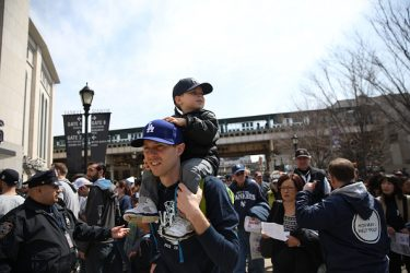 Fans arrive at Yankee Stadium before the New York Yankees Vs Toronto Blue Jays season opening day at Yankee Stadium, The Bronx, New York. 6th April 2015. Photo Tim Clayton (Photo by Tim Clayton/Corbis via Getty Images)