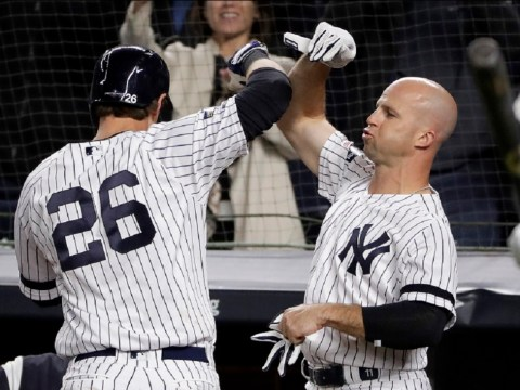 New York Yankees' DJ LeMahieu (26) is congratulated by Brett Gardner after hitting a solo home run against the Minnesota Twins during the sixth inning of Game 1 of an American League Division Series baseball game, Friday, Oct. 4, 2019, in New York. (AP Photo/Frank Franklin II)