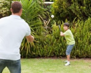 Father and son bonding in the backyard