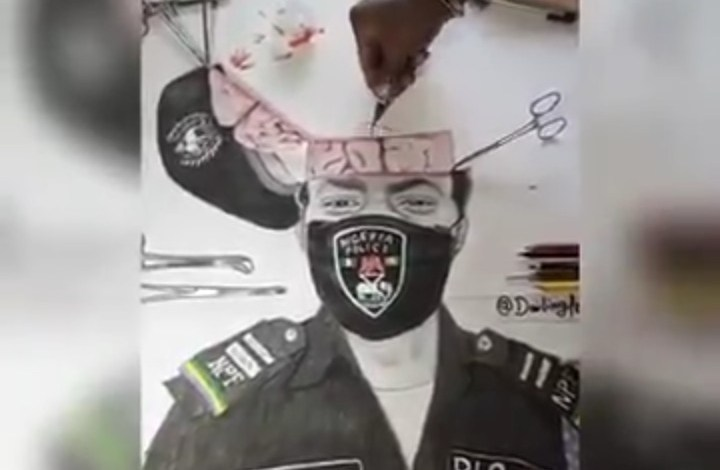 Photo of #EndSARS Protest: Artist Performs Artistic Brain Surgery on Police Officer [Video]