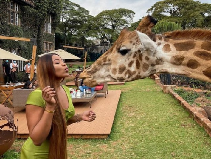 Erica Shares Pictures of Blowing a Kiss With Giraffe in Kenya