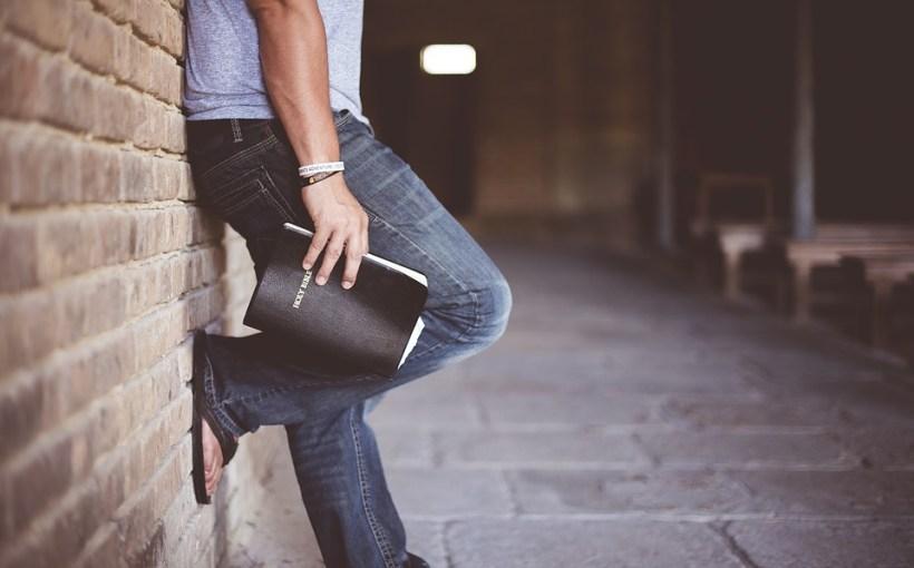 Man holding bible, preacher