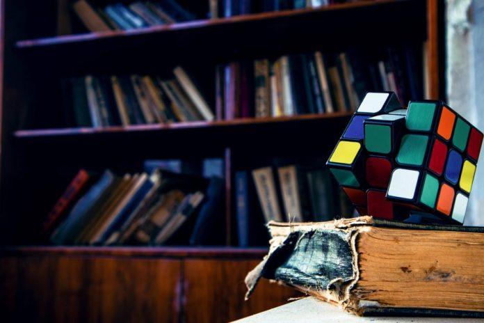 rubik s cube on book