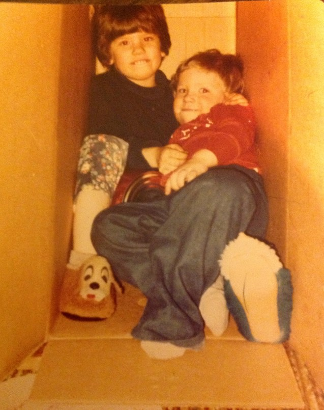 My little brother and I playing in a box. We were best friends when we were kids.