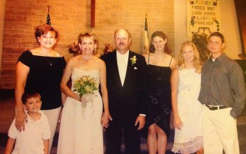 My mom's wedding to my new stepdad with my new stepsister, stepbrother and his wife, and my son.