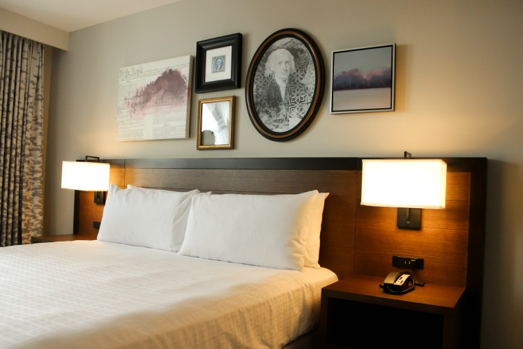 Contemporary styling and detailed artwork define this Hotel Madison guest room.