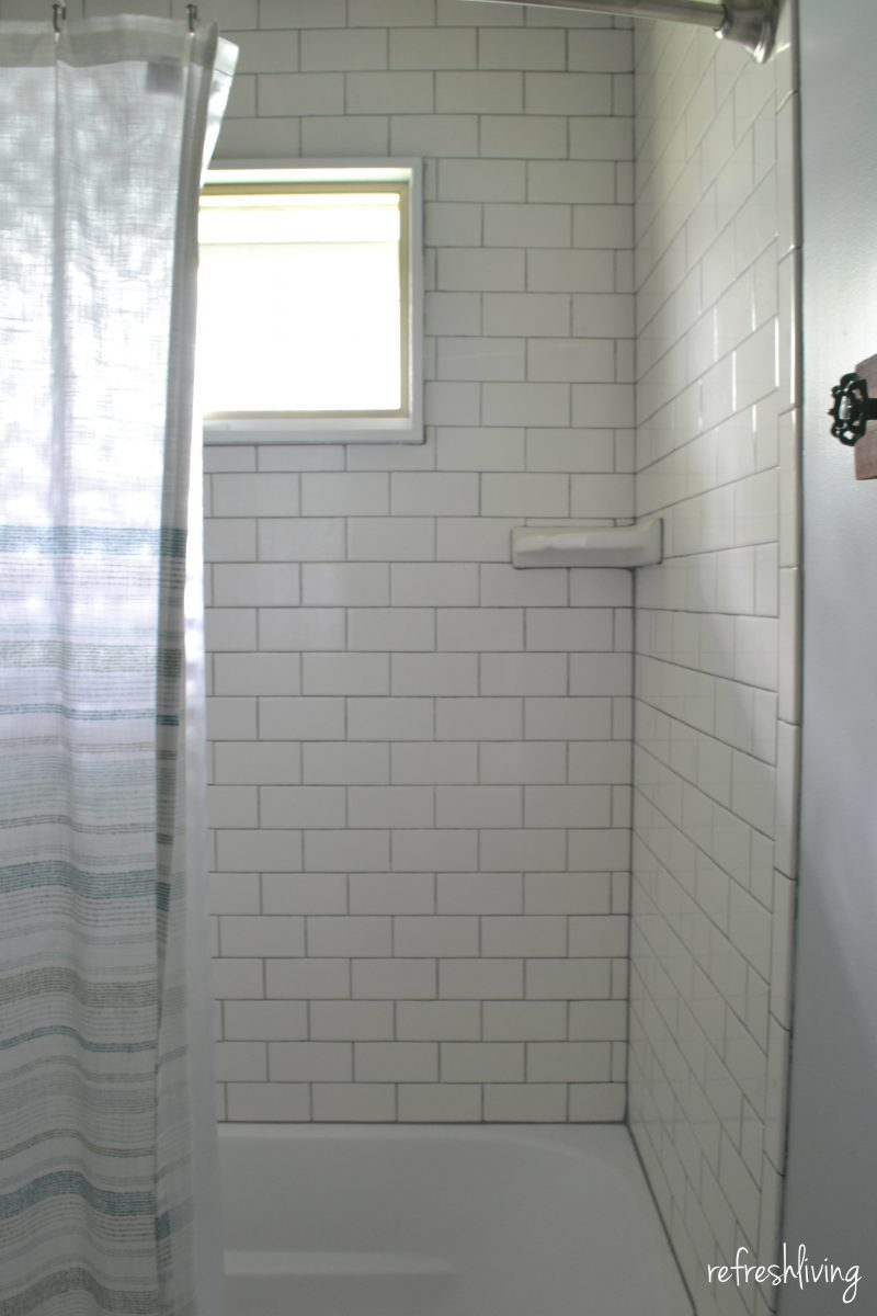 bathroom remodel with white subway tile
