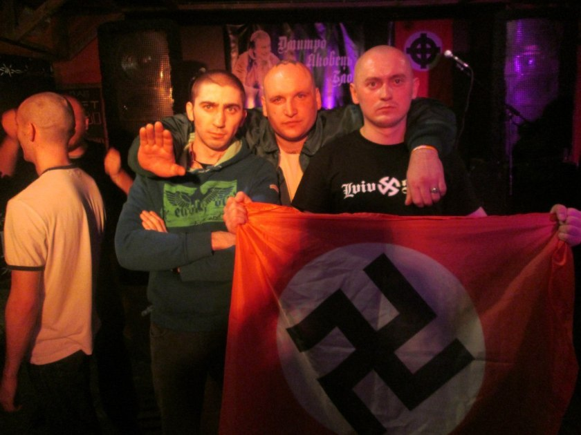 From left to right: Ivan Koltsov, Artem Bonov, and Taras Hummer Bobanych at a neonazi concert in the memory of a deceased football hooligan Dmytro Yakovets. Lviv, 30 March 2013.