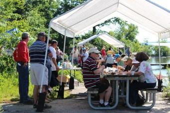 Happy Customers enjoy breakfast on Refugee Island