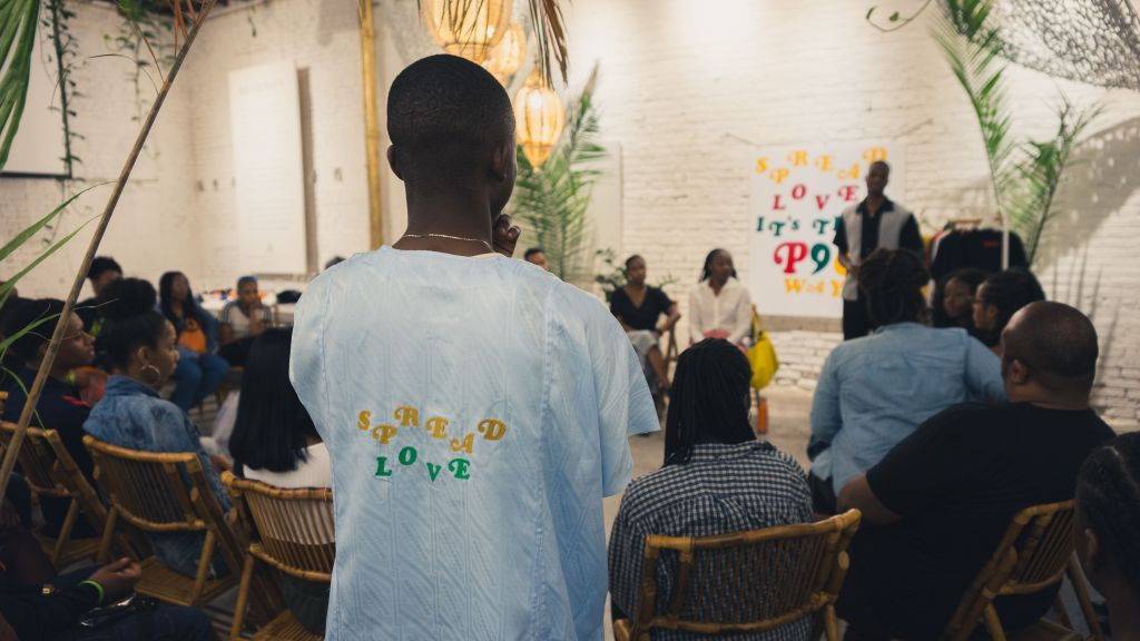 Man stands for discussion at a workshop by Project 96 summer activation experience