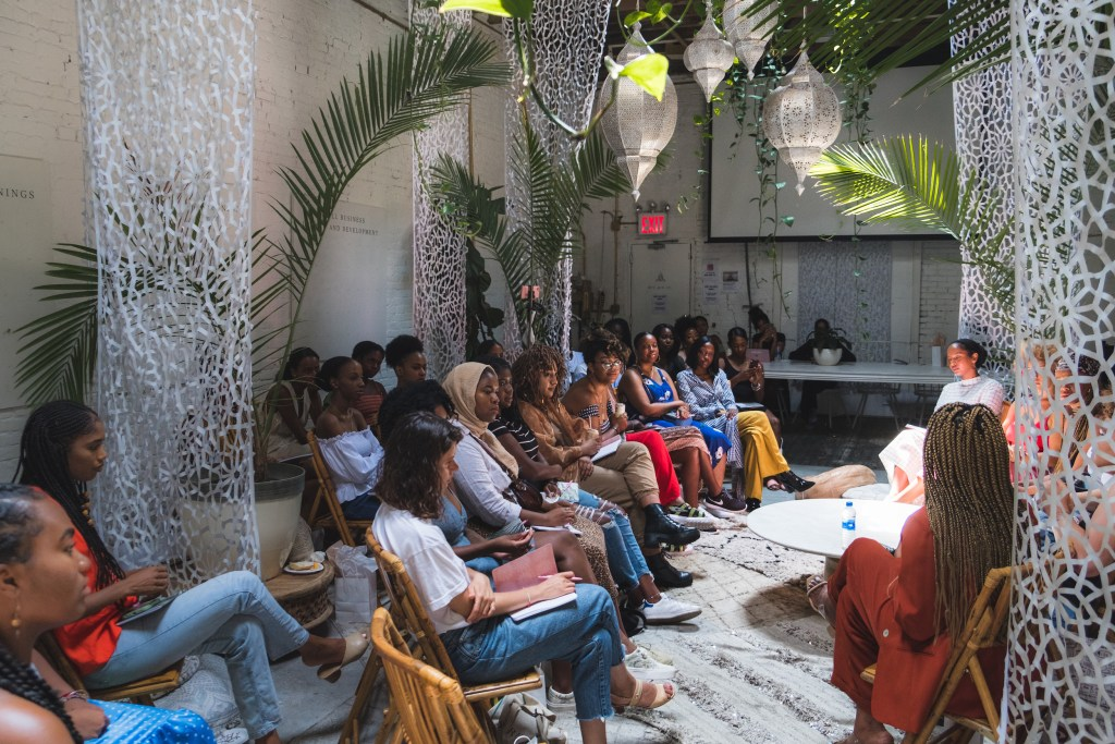 Ring of women talking at the White Room of Regency Community and Event Venue