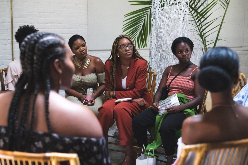 Women speak intently at the White Room of Regency Community and Event Venue