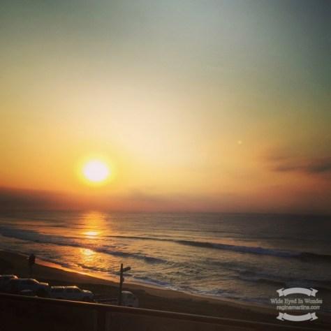 The sun rising over the sea ©2016 Regina Martins