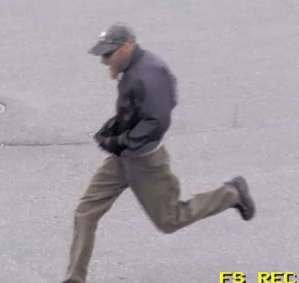 """The Regina Police Service is looking to identify theindividual in this series of still images, in relation to a purse-snatching that occurred in a parking lot on the 2100 block of Prince of Wales Drive on on June 13th, 2017, at approximately 7:12 p.m. The suspects is described as a Caucasian male, approximately 5'10"""" to 6' tall, with reddish hair, mid-length beard goatee, wearing a camouflage hat, dark windbreaker, tan pants, black gloves, and sunglasses."""