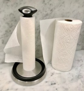 Comparing roll of bsmboo wipes with paper towels. Bamboo wipes are on paper towel dispenser. Paper towels just sitting there.