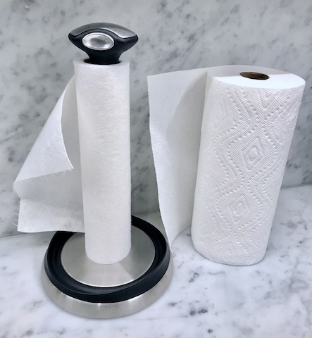 Comparing roll of bamboo wipes with paper towels. Bamboo wipes are on paper towel dispenser. Paper towels just sitting there.