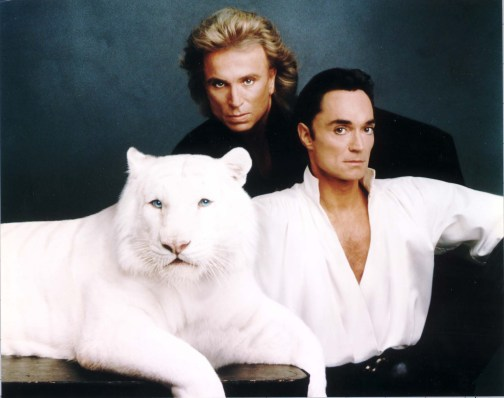 Siegfried Fischbacher, left, and Roy Uwe Ludwig Horn, with one of their animals a white tiger.