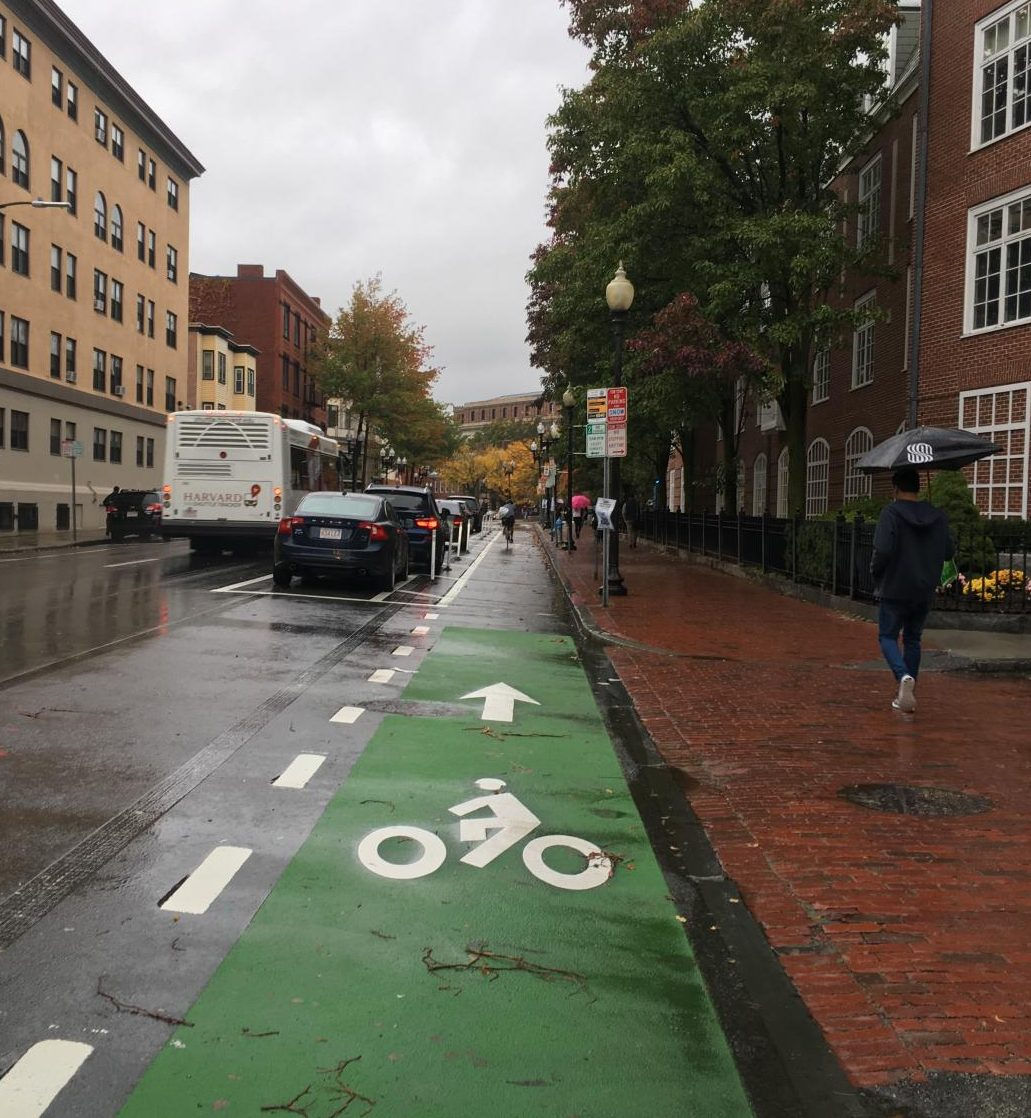 A bike lane outside of Harvard Square allows bicycles to have a separate place to ride but takes away from space on the street for cars.