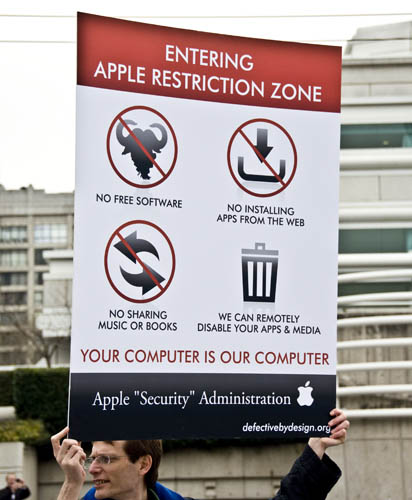Defective by Design protest sign