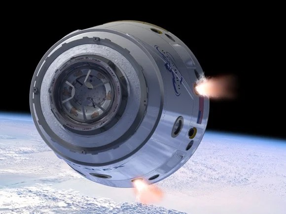 The Dragon capsule with 'Draco' rockets in action. Credit: SpaceX