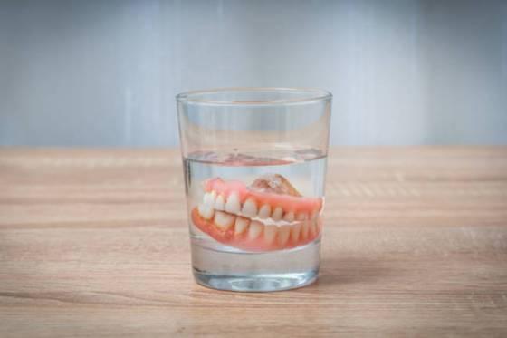 false teeth in glass