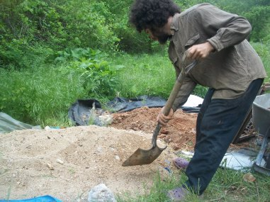 Carlos digging sand.