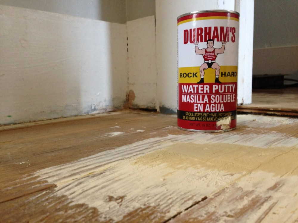 How to repair a damaged floor before painting.