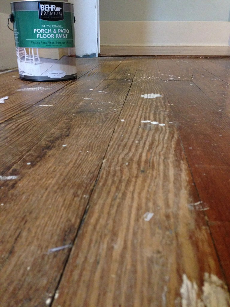 Painting a floor with porch paint.