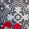 Installing faux encaustic tile in a Victorian bathroom.