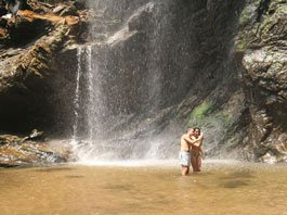 couple enjoying waterfall