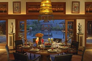 luxury dining room with view of pool